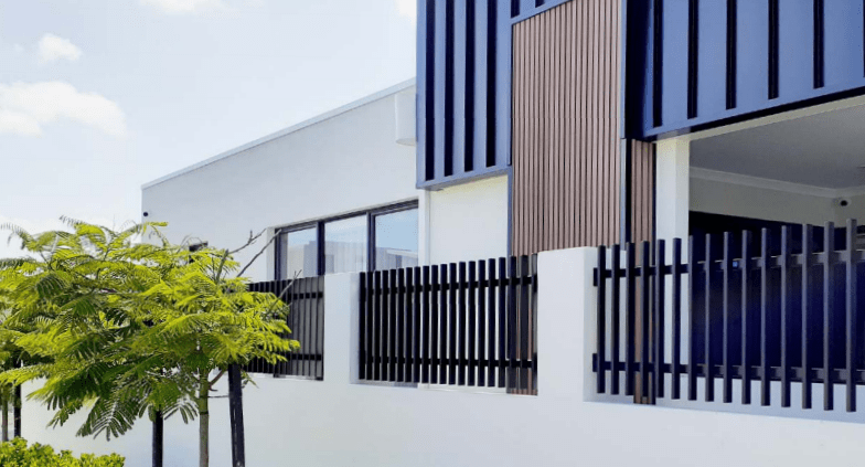 house with steel fence wall