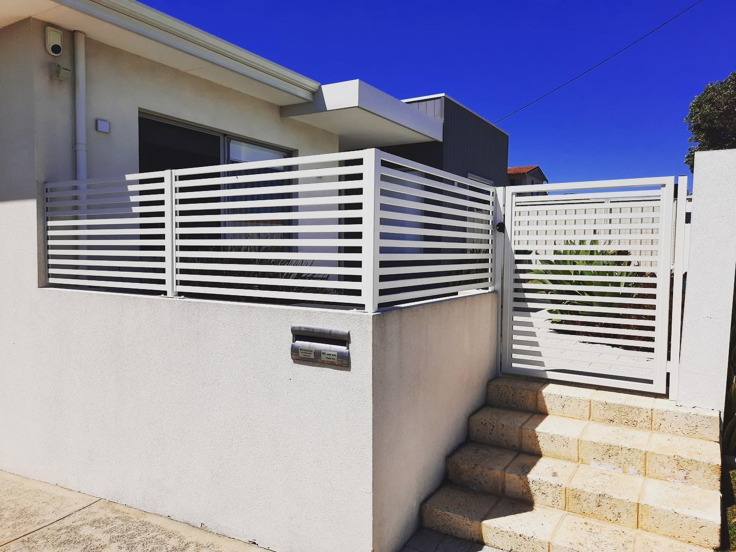 White wall with slat fencing