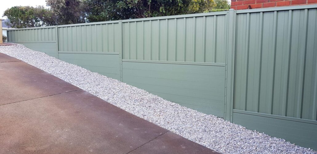 Green Fence With Aliretain Fencing Plinths